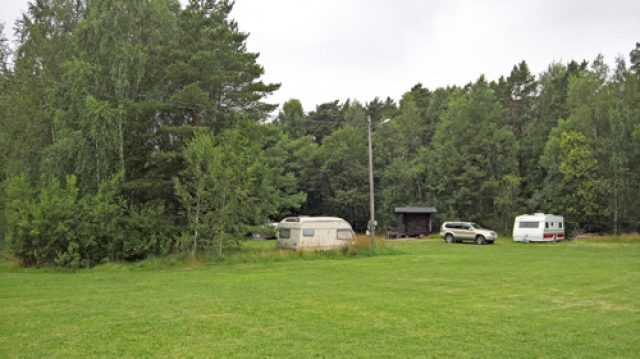 Camping area for caravans next to the grass field